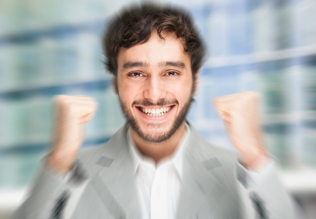Portrait of an happy young man